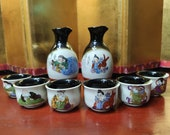 Japanese Kutani Sake Set With Painting Of The 7 Japanese Gods of Good Fortune