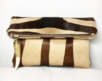 Serengeti Foldover Clutch (Medium) Zebra Print Hair On Hide with Brass and Cream Tusk Charm