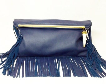 Noche Fringe Foldover Clutch in navy blue leather and ivory tusk charm