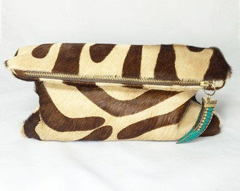 Serengeti Foldover Clutch (Large) - Zebra Print Calf Hair Leather with Tusk Charm
