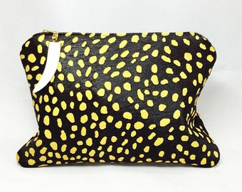 Electric Safari Clutch- black and electric yellow spotted calf hair leather with ivory tusk charm with gold hardware