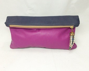 Katia clutch. Navy blue and fuchsia purple color blocked leather with beaded tusk charm
