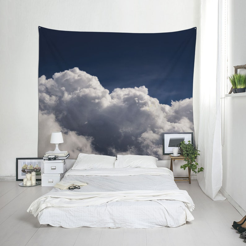 Cloudscape tapestry under a navy blue sky dorm wall art or image 0