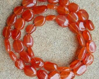 "Carnelian Oval Flat Nugget Beads, 8-10mm x 5-9mm - 14"" Strand"