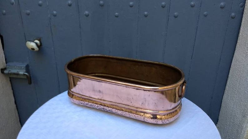 Large hand made and hammered heavy and handsome French vintage copper planter  jardiniere with handles circa early 1900s.