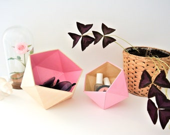 light wood and light pink origami boxes