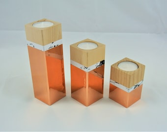 set of three wooden candle holders, copper and marble