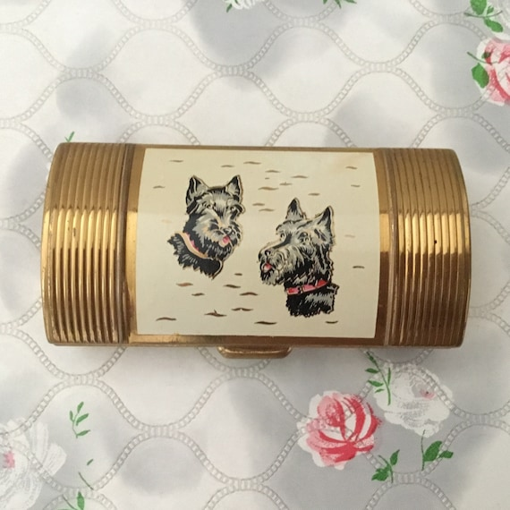 Barrel shaped ladies cigarette case, with black Scottie dogs, c 1950s vintage gold metal bolster lipstick holder, with highland terriers