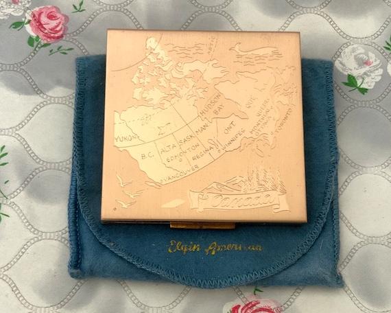 Elgin American powder compact with Canadian map, 1950s vintage souvenir of Canada makeup mirror