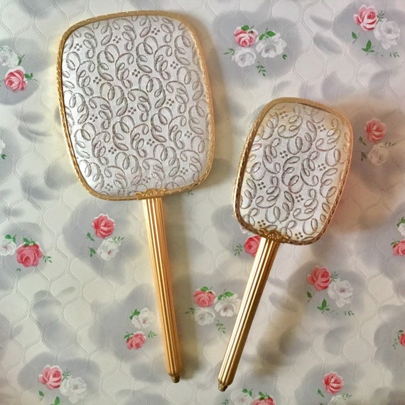 1960s or 1970s brush set with a hand mirror and hairbrush, mid century gold tone dressing table vanity set with metallic lamé fabric