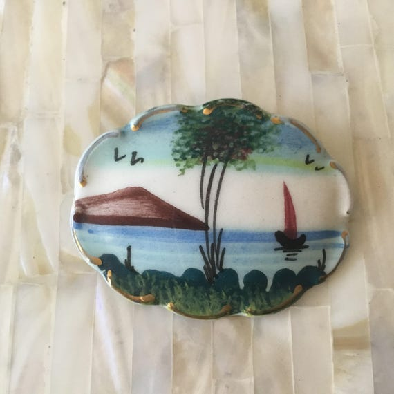 Vintage hand painted porcelain brooch, c1920s this ceramic brooch is hand painted with a seascape brooch