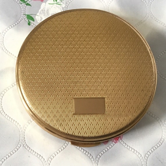 Gold tone Kigu loose and cream powder compact, c1960s or 1970s