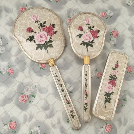 Vanity dresser set with pink roses and lace, vintage hand mirror, hairbrush and clothes brush, mid century ladies dressing table set