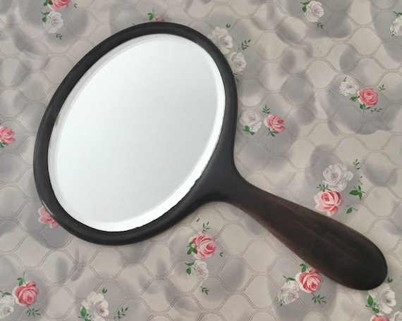 Antique dark ebonised wood hand mirror, Edwardian or early 20th century vintage vanity mirror, ebony style with oval bevelled glass