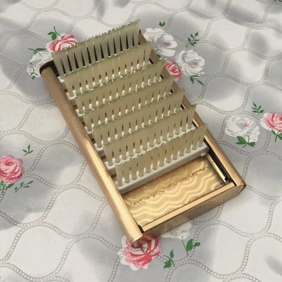 Stratton gold tone compact hairbrush, c 1950s vintage portable travel or handbag brush