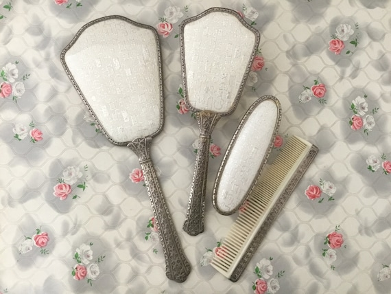 Regent of London hand mirror, hairbrush, clothes brush and comb set, c1950s or 1960s gold lamé vintage vanity set