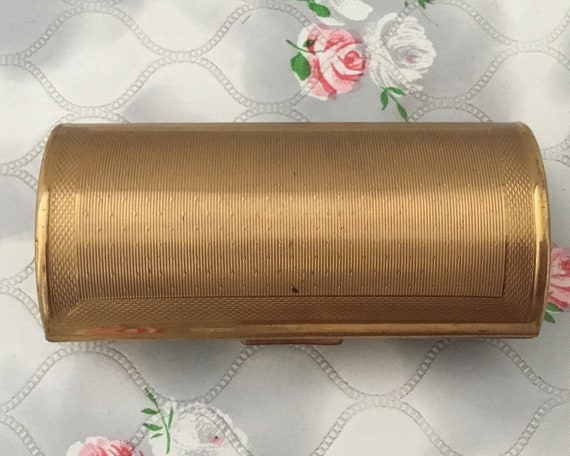 Kigu ladies barrel cigarette case, c 1960s vintage gold metal lipstick holder, handbag smoking accessory