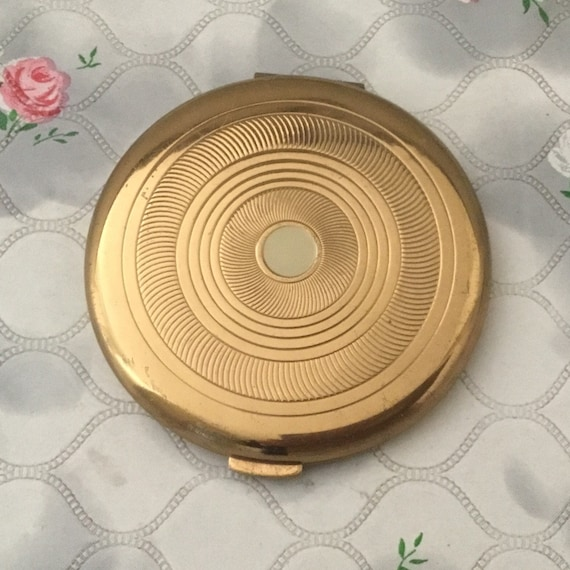 Coty loose powder compact with white spot, c 1950s 1960s vintage gold tone handbag makeup mirror