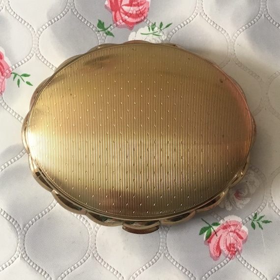 Kigu concerto musical loose powder compact, gold tone c 1950s, vintage gold tone makeup mirror