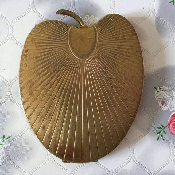 Volupte Garden of Eden loose powder compact, vintage gold apple shaped makeup mirror c 1950s,