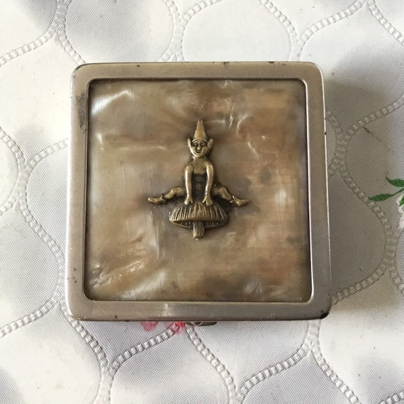 Vintage souvenir powder compact with Cornish pixie and toadstool on celluloid lid, c 1930s or 1940s