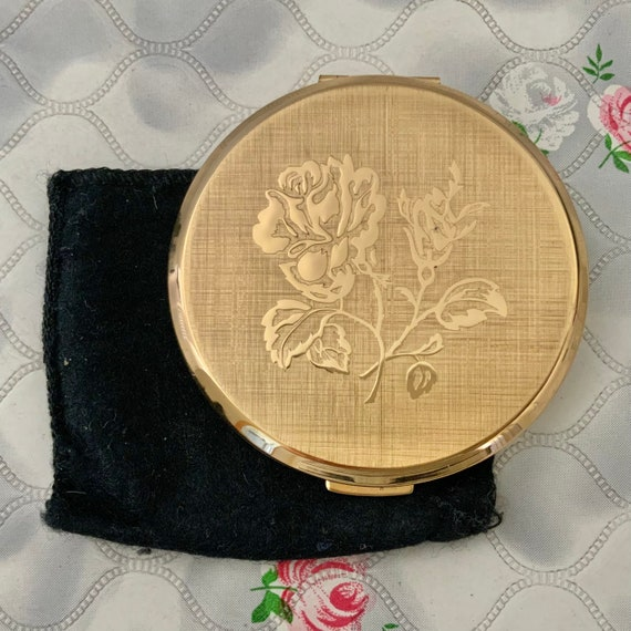Stratton convertible powder compact, goldtone with a rose, c 1960s or 1970s makeup mirror compact