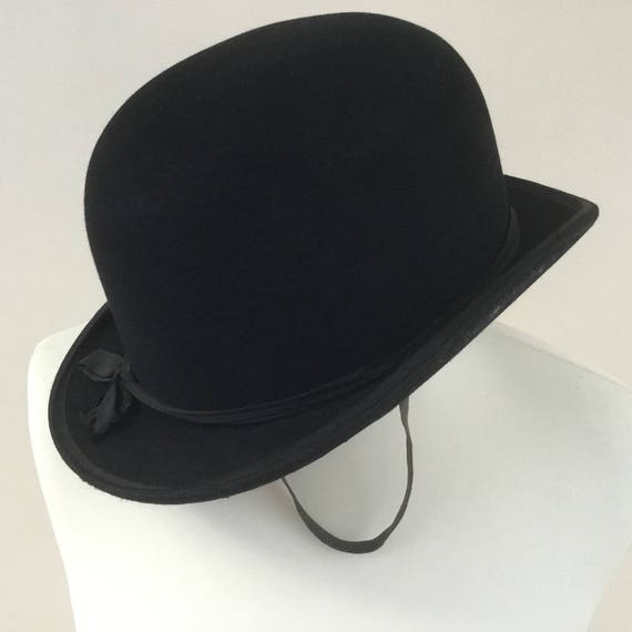 Ladies black bowler hat with chin strap, c1940s or 1950s, Mrs White branded womens riding bowler hat by A J White ltd, 21 inch hat size 54cm