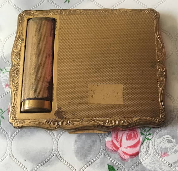 Vintage Stratton compact lipstick holder, c1950s, a gold tone Empress Stratton powder and lipstick duo compact