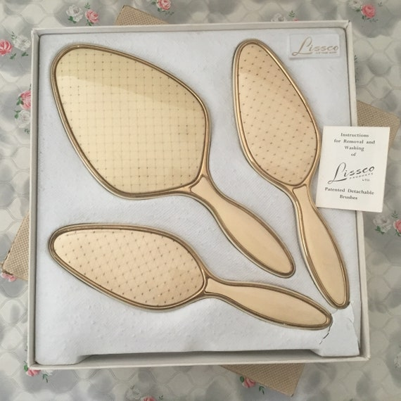 Lissco brush set with vintage hand mirror, clothes brush and hairbrush, c 1960s boxed dresser set, cream and gold dressing table vanity set
