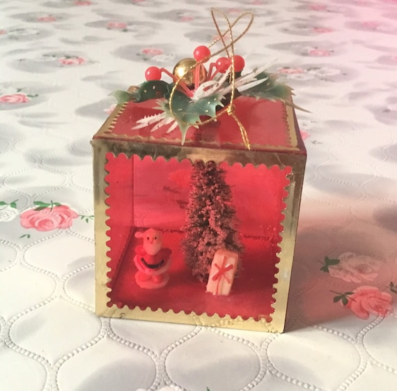 Red plastic diorama Christmas decoration with Santa Clause and bottle brush tree,1970s Xmas ornament, mid century cube bauble,