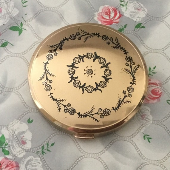 Melissa cream powder compact, gold with black flowers c1960s or 1970s, vintage handbag makeup mirror
