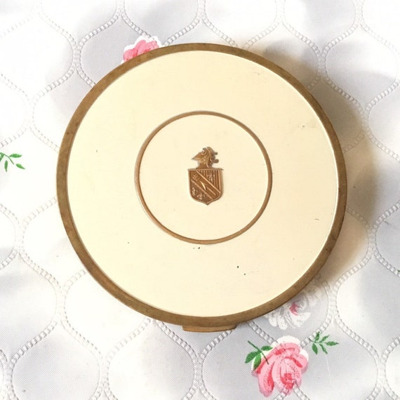 Jaquet loose powder compact, c 1930s or 1940s cream vintage compact with coat of arms, handbag makeup mirror made in America