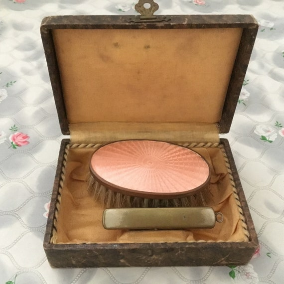 Peach Guilloché enamel hairbrush or clothes brush, with nail buffer and box
