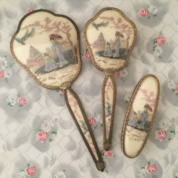 Regent of London boxed Japanese ladies vanity set with hand mirror, hairbrush and clothes brush, c1950s or 1960s