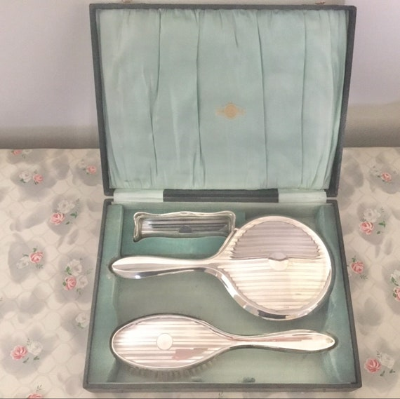 Art Deco EPNS vanity set with hand mirror, hairbrush and trinket dish, c 1930s silver dresser set and box