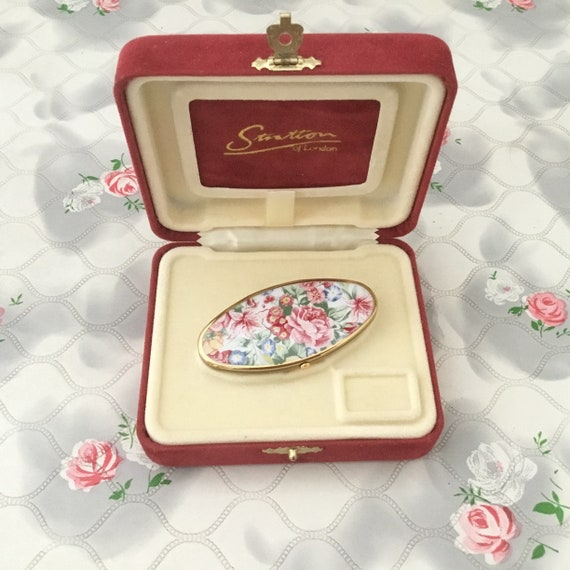 Stratton Lipview lipstick holder and compact lip mirror, c 1990s, vintage gold tone makeup accessory with pink flowers