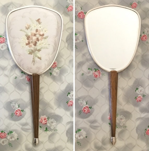 Ladies hand mirror, c1960s with brown and yellow embroidered flowers and wood effect handles,