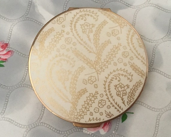 Stratton loose powder compact with cream lid and gold flowers and leaves, vintage 1950s or 1960s makeup mirror