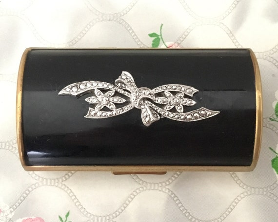 Kigu barrel cigarette case with black lid and marcasites, c 1950s or late 1940s vintage gold metal lipstick holder