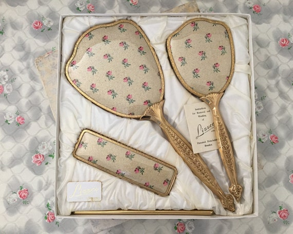 Lissco brush set, c 1960s, with box, gold and pink rose bud dresser set with hairbrush, hand mirror, clothes brush and comb