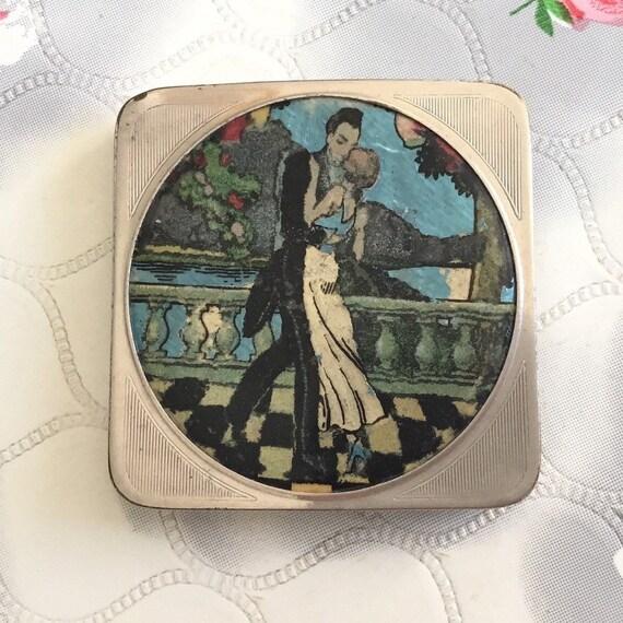 Stratnoid non-spill loose powder compact, with foil art deco couple, silvertone makeup mirror, 1920s or 1930s vintage handbag mirror