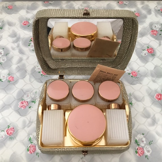 Sirram ladies mid century beauty box with faux snakeskin, vintage overnight vanity case with mirror, lidded pots, and pink jars,