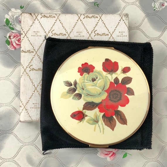 Stratton powder compact, with red flowers and white rose, c1970s or 1980s unused vintage gold and floral convertible makeup mirror