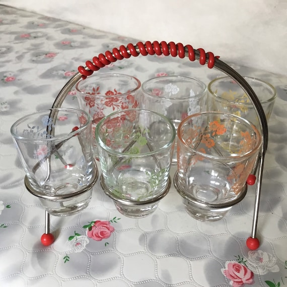 Atomic bar set with vintage shot glasses and stand with red ball feet, mid century 1950s barware set with six retro glasses,