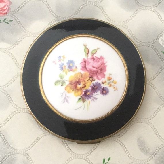 Mascot cream powder compact, with white ceramic tile, c 1960s vintage makeup mirror with pink rose and yellow flowers on a porcelain plaque