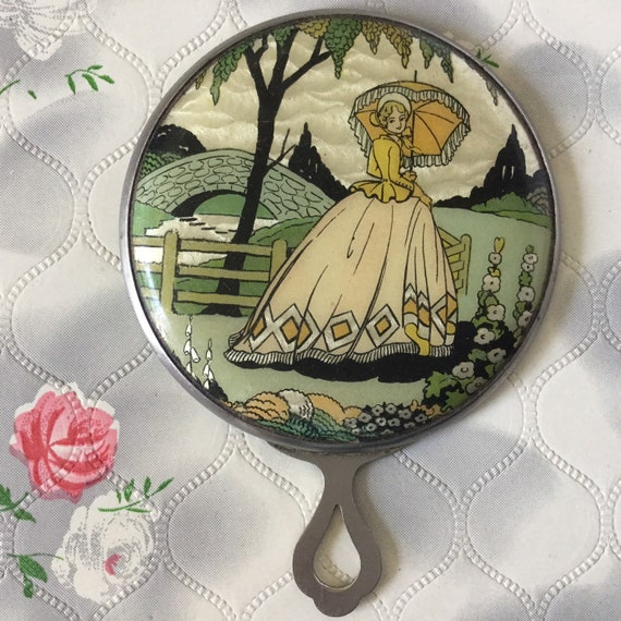 Vintage Gwenda magnifying makeup mirror with foil crinoline lady, c 1930s or 1940s vanity hand mirror