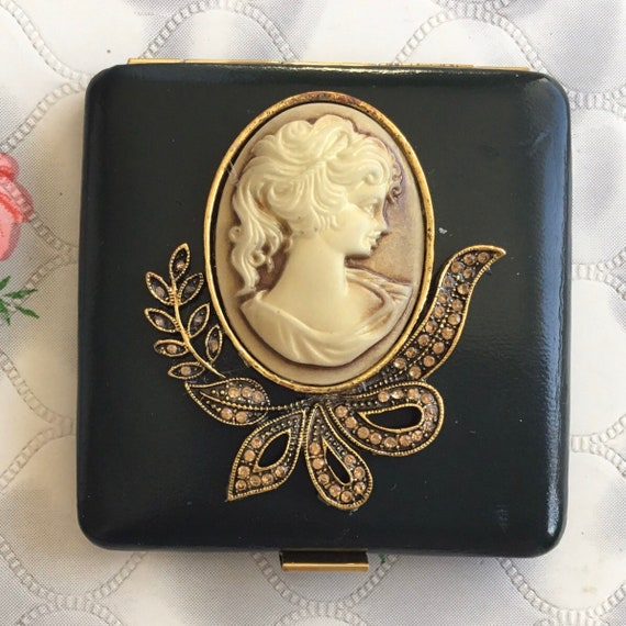 Powder compact with faux leather and cameo, c 1960c or 1970s Vintage DBGM Emrich convertible handbag makeup mirror,