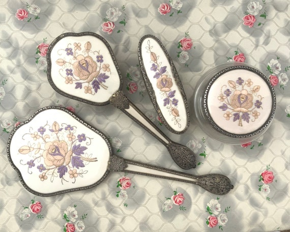 Regent of London dresser set with hand mirror, hairbrush, powder bowl and clothes brush, c1950s with pink and lilac embroidery