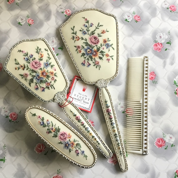Regent of London dresser set with hand mirror, hairbrush, clothes brush and comb, with petit point embroidered pink flowers c 1950s