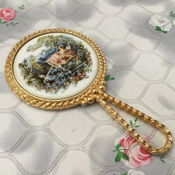 Mascot compact handbag mirror, with porcelain tile,  mid-century 1960s or 1970s mini vanity mirror, with The Swing by Jean Honoré Fragonard